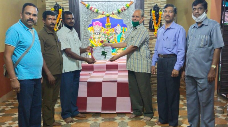 Ganesh Barku Khedekar (Vaikunthrath Driver Chiplun) and Vishwanath Vasant Pawar being felicitated as Covid Warriors on behalf of Outreach Center for Extension Activities for their outstanding work of cremation of covid bodies during lockdown period at chiplun.